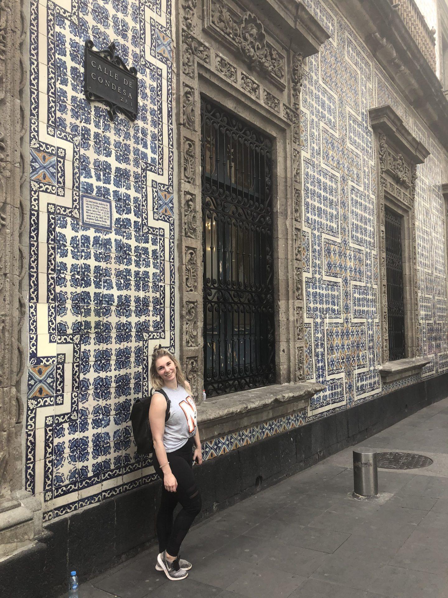 Girl outside The House of Tiles, or La Casa de Azulejos