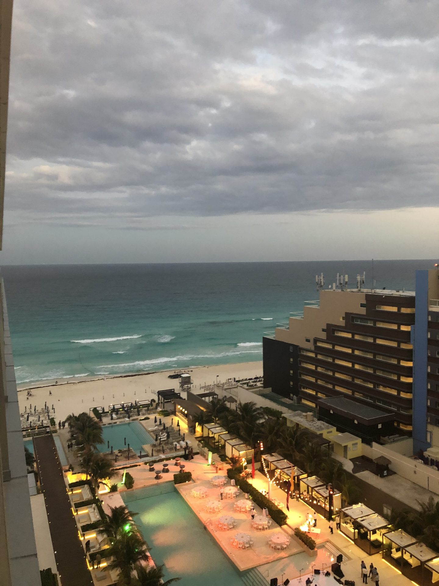 View from our room at Secrets The Vine Cancun at dusk