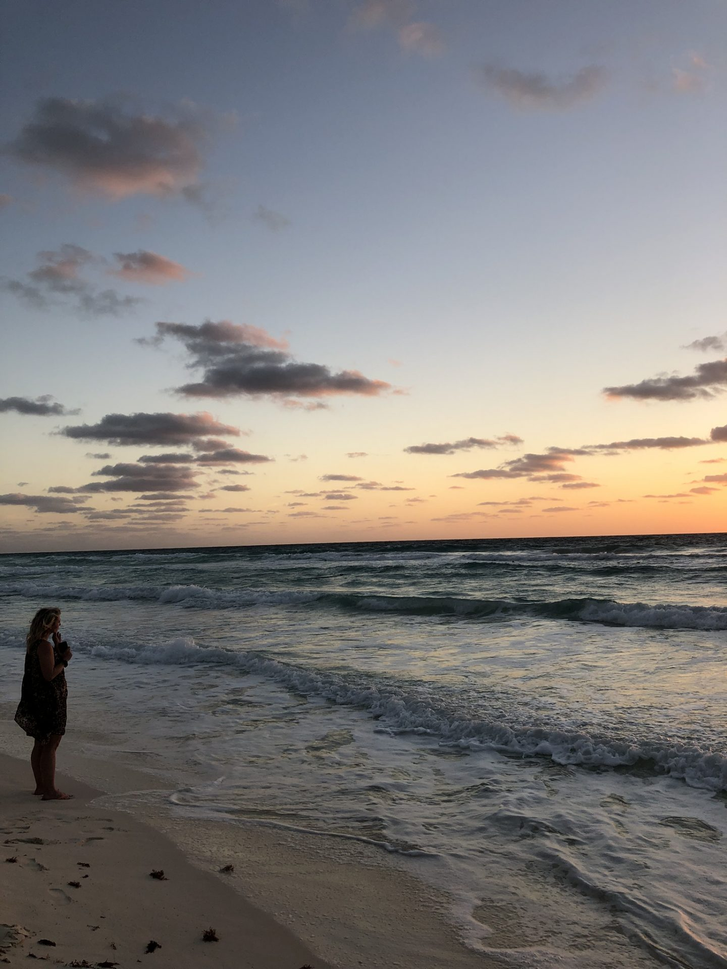 Girl on the beach at sunrise, Cancún