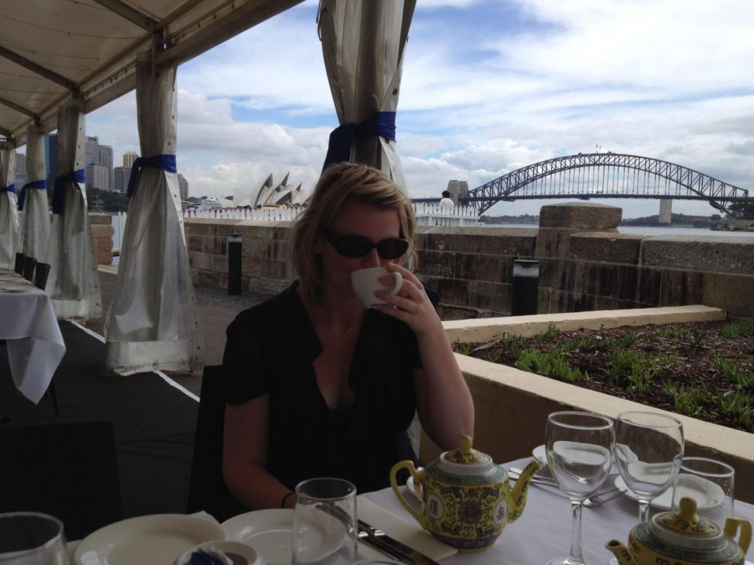 Laura drinking tea with Sydney Harbour Bridge in the background