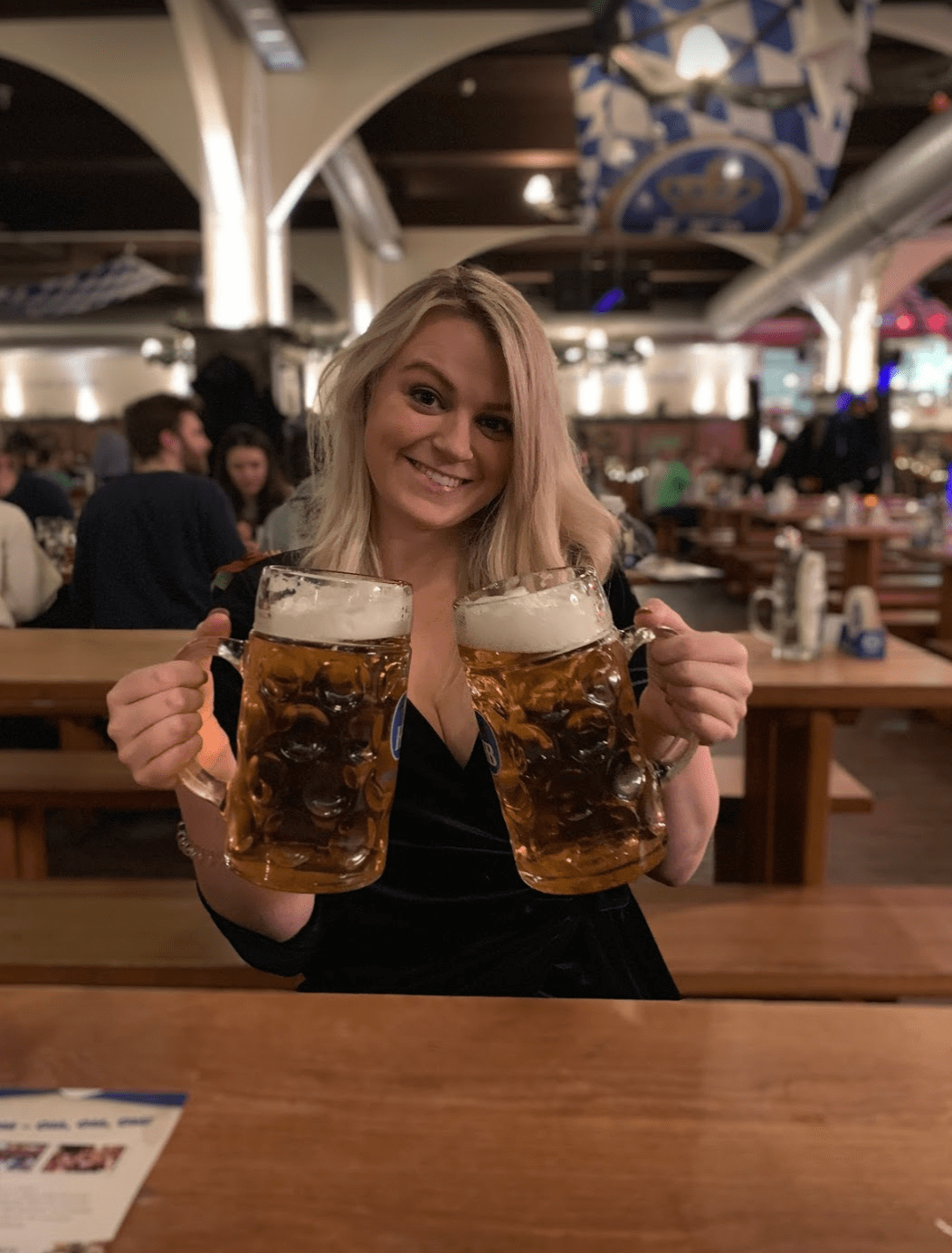 Laura with steins of beer at Hofbräuhaus, Berlin