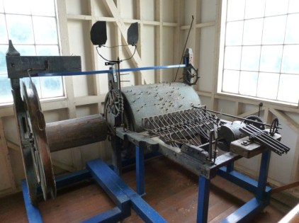 The clock's carillon mechanism, with a large cylinder for striking hymn tunes, and a smaller cylinder to sound the time.