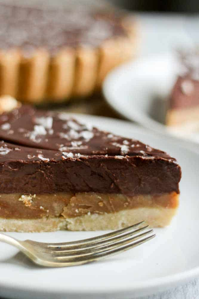 This chocolate caramel tart is paleo, gluten-free and vegan! Made with whole natural ingredients, this tart recipe is naturally sweet and satisfying.