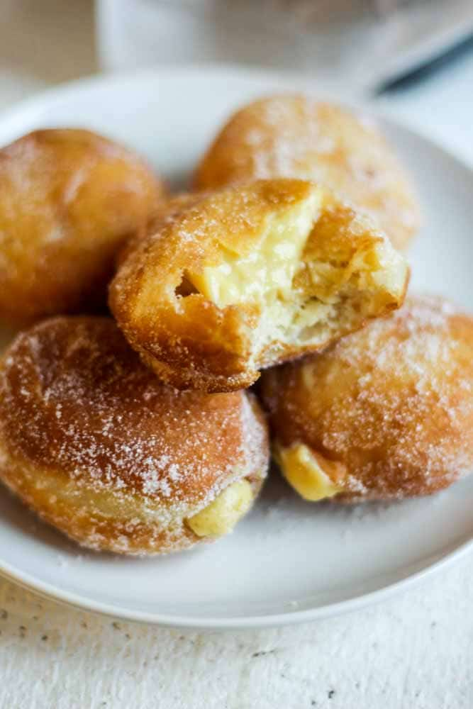 Brioche Doughnuts are the perfect breakfast recipe or dessert recipe to make for a crowd. They're light, crispy and filled with pudding-like vanilla pastry cream. This donut recipe is a classic cream filled doughnut everyone will love.