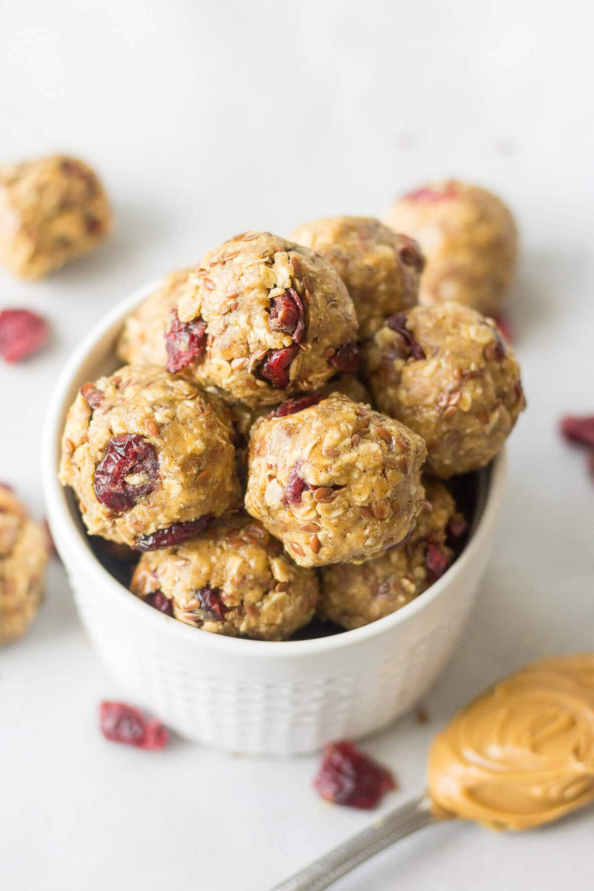 These PB & J Protein Balls are going to be your new favorite bite-sized snack! They're made with all healthy ingredients and packed with protein for a filling snack on-the-go.
