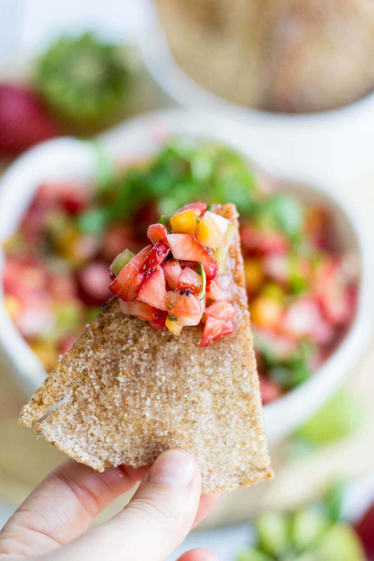 Sweet and healthy at the same time, this fruit salsa is made with fresh fruit and scooped up with a crunchy homemade cinnamon sugar pita chips. This healthy summer dessert means no oven and lots of healthy fruit. You're summer parties will be complete with this healthy recipe.