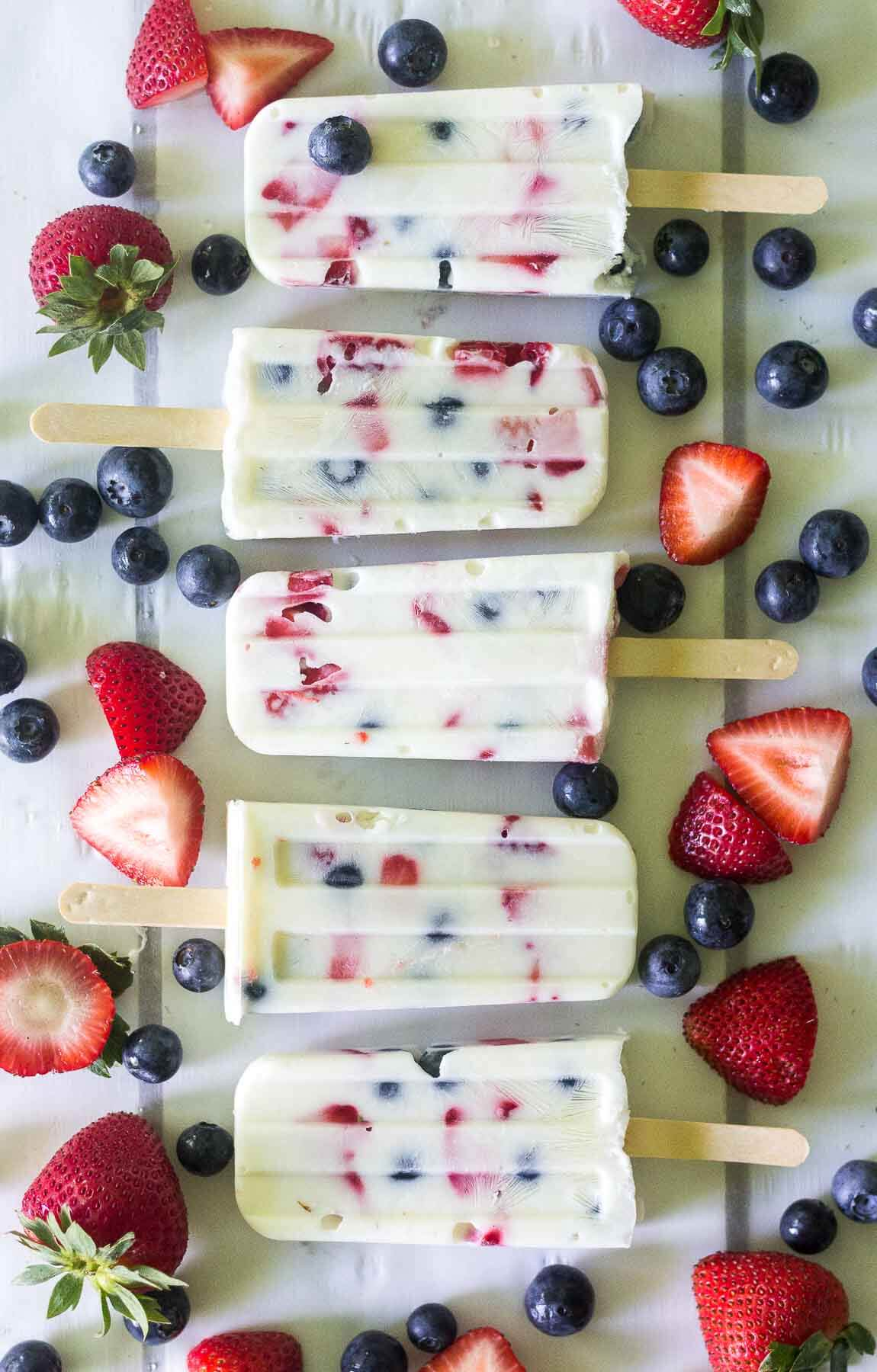 These red, white and blue yogurt popsicles are such a festive and healthy recipe to celebrate 4th of July! With only 3 ingredients, you can make this healthy pops in minutes.