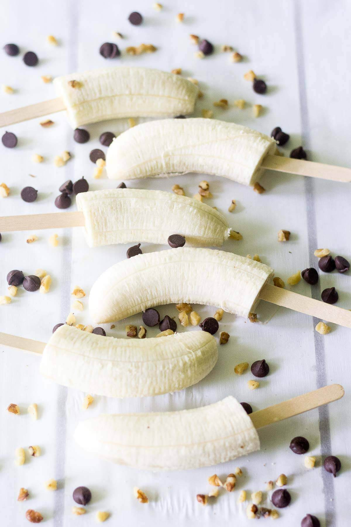 This healthy frozen treat is a guaranteed crowd pleaser! You're going to flip for how easy they are to make and all of the natural, healthy ingredients you use to make them. Make a bunch of these paleo frozen bananas and keep them in the freezer for whenever you and your family need a sweet (but healthy) dessert.