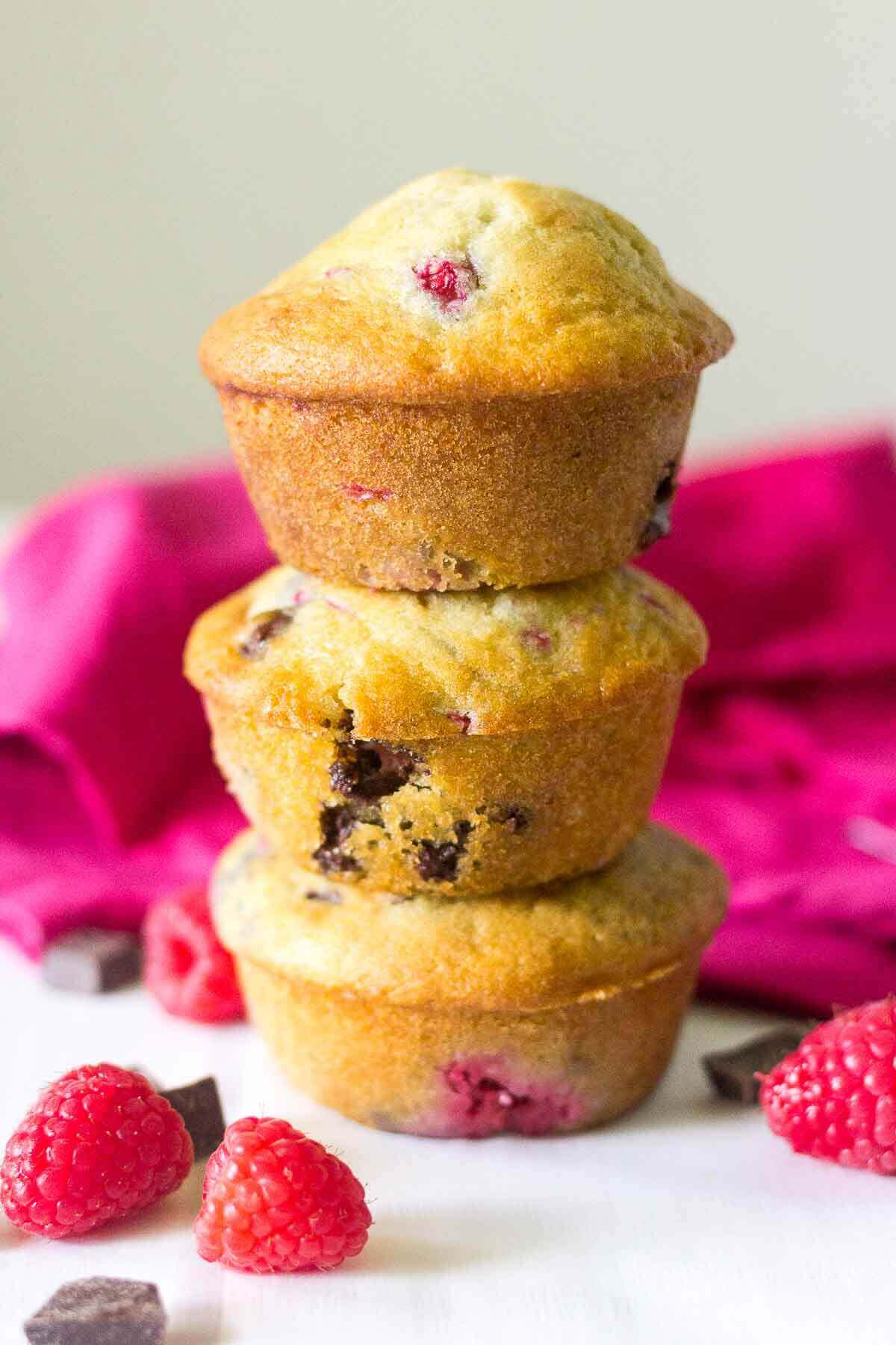 Soft and buttery muffins packed full of yummy ingredients! These Raspberry Chocolate Chunk Muffins will make your next Monday mornings the best yet. The melty chocolate oozes with each bite and the raspberries burst with flavor.