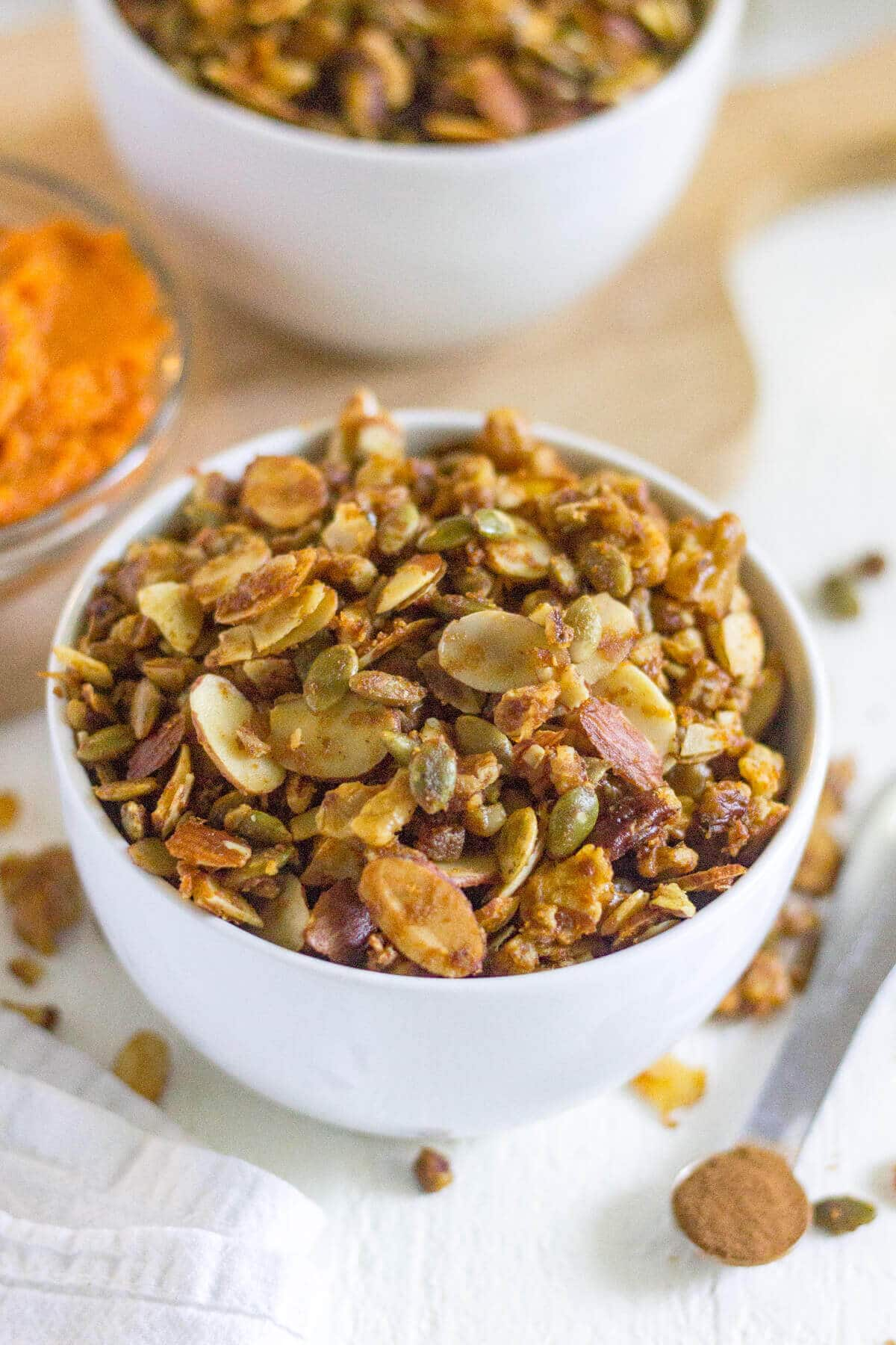 Grain free pumpkin granola is your next easy, gluten free and paleo breakfast for fall! Made with nuts, seeds, coconut and pumpkin spice, this healthy breakfast recipe will start your day with a crunch.