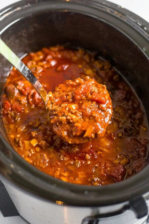 paleo chili in a crock pot with a ladel