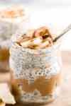 peanut butter and banana overnight oats in a jar with a spoon
