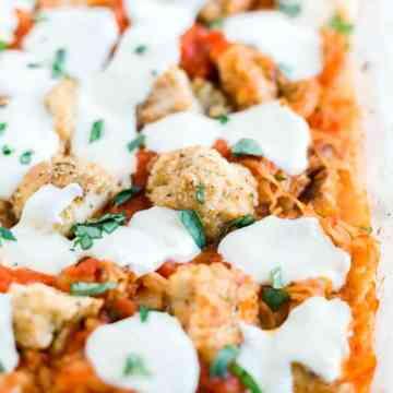 chicken parmesan spaghetti squash casserole in a dish with fresh basil