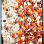 greek chicken with mixed veggies on a sheet pan