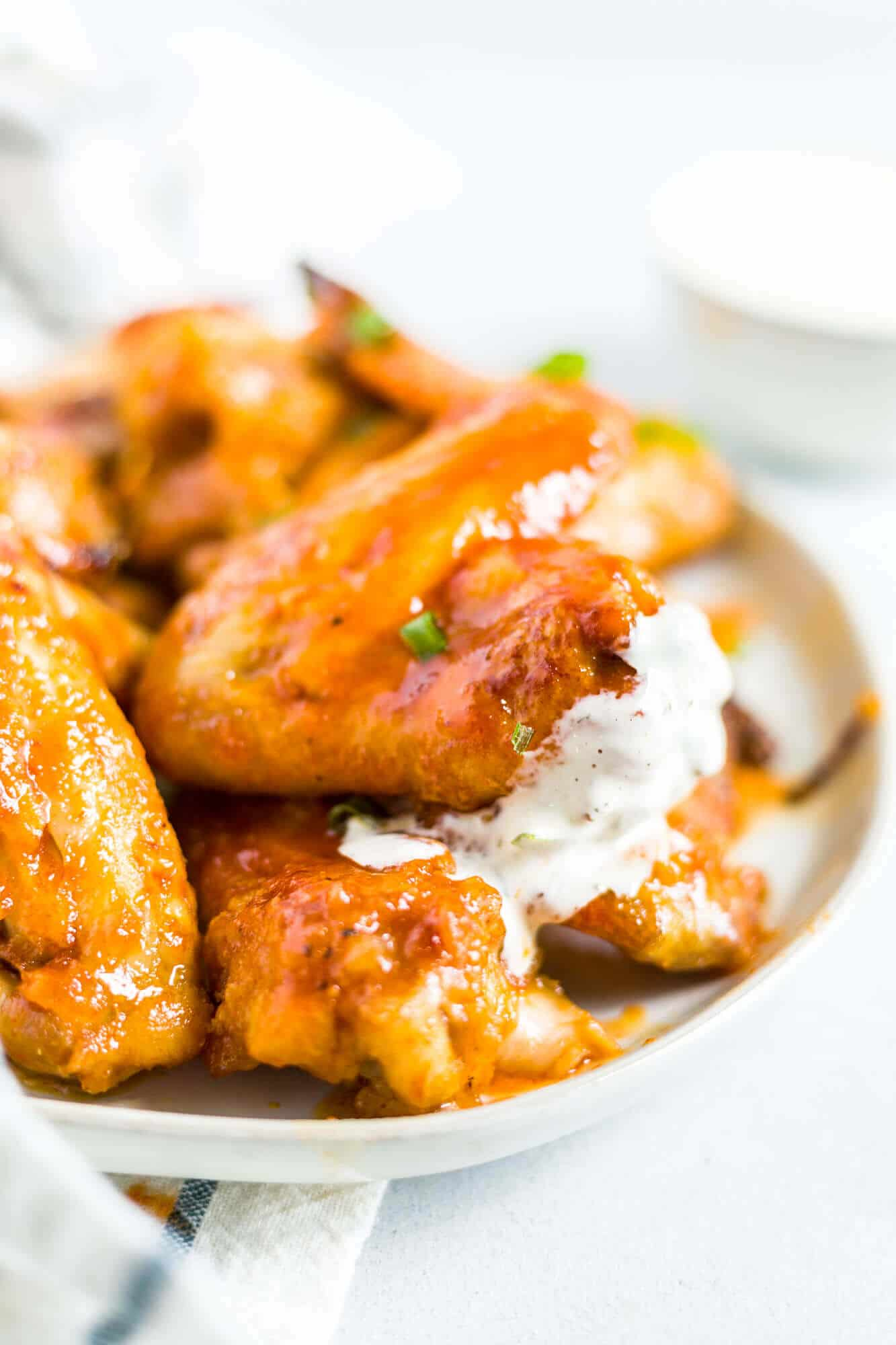 honey sriracha wings on a plate with ranch