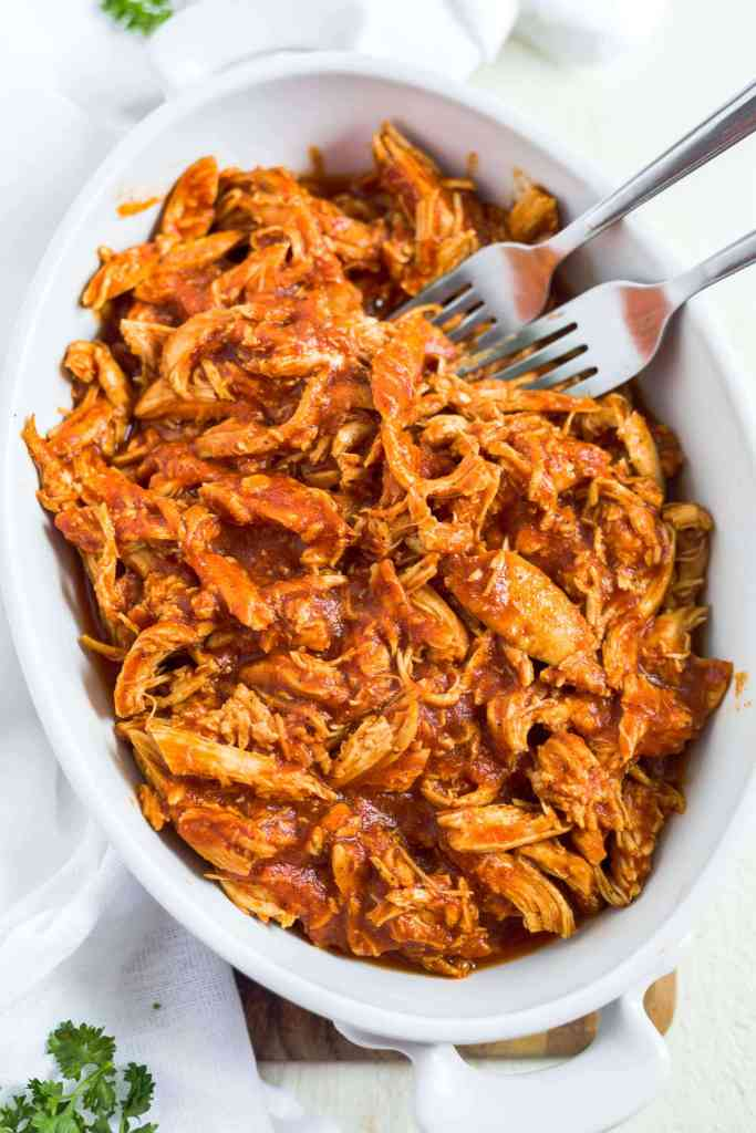 bbq pulled chicken in a white serving dish