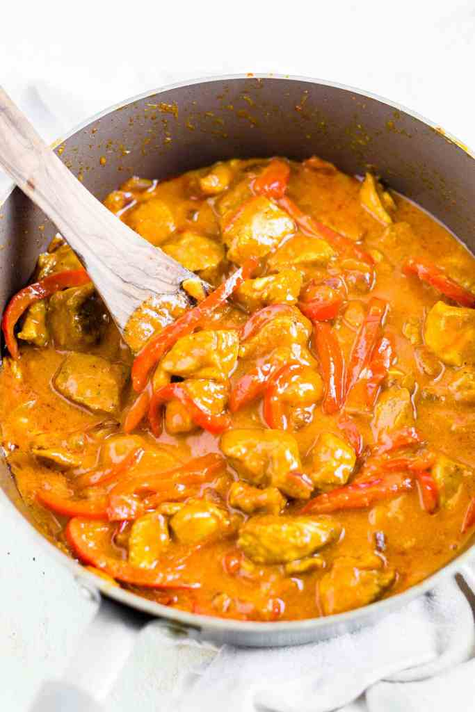 chicken curry with coconut milk in a pan