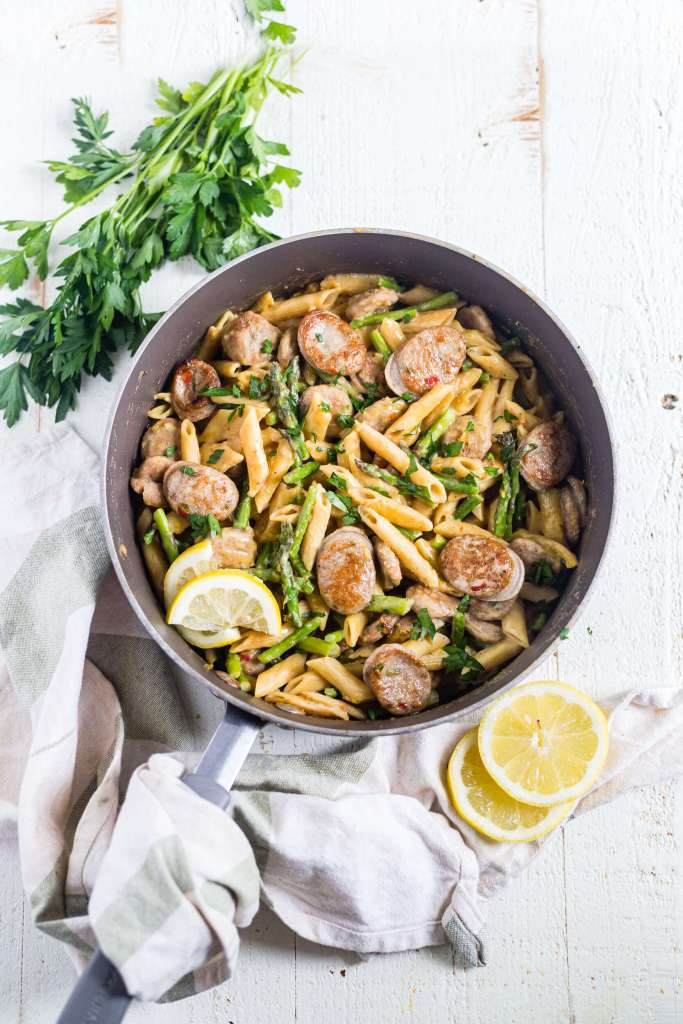 one pot lemon chicken asparagus pasta with parsley and a kitchen towel