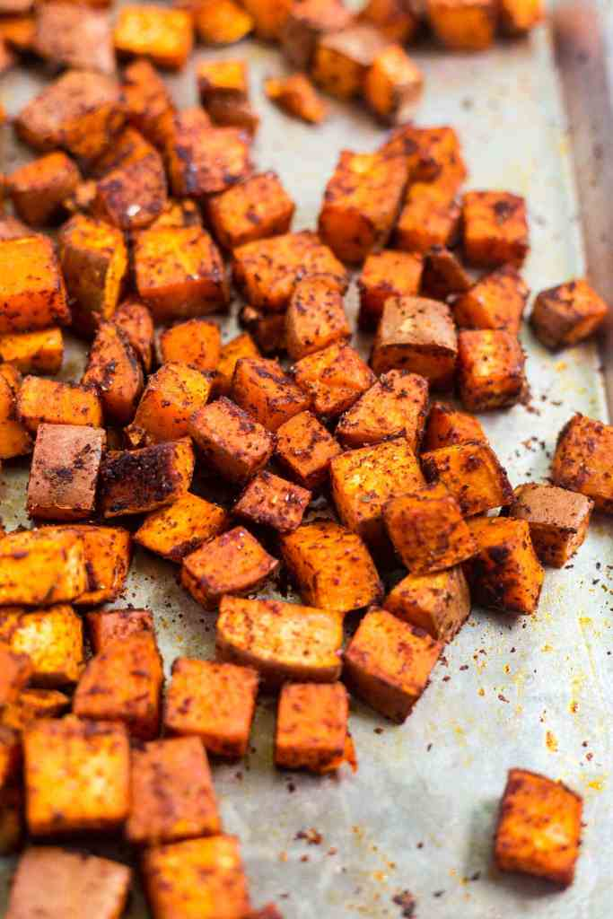 chipotle roasted sweet potatoes on a sheet pan