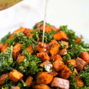 cilantro vinaigrette pouring onto chipotle sweet potato salad
