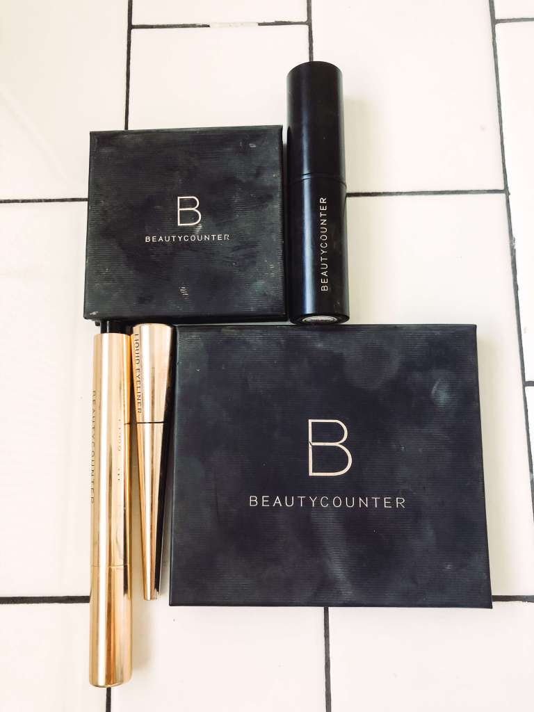 4 beauty counter products on white subway tile