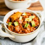 turkey pumpkin chili in a bowl with diced avoacdo