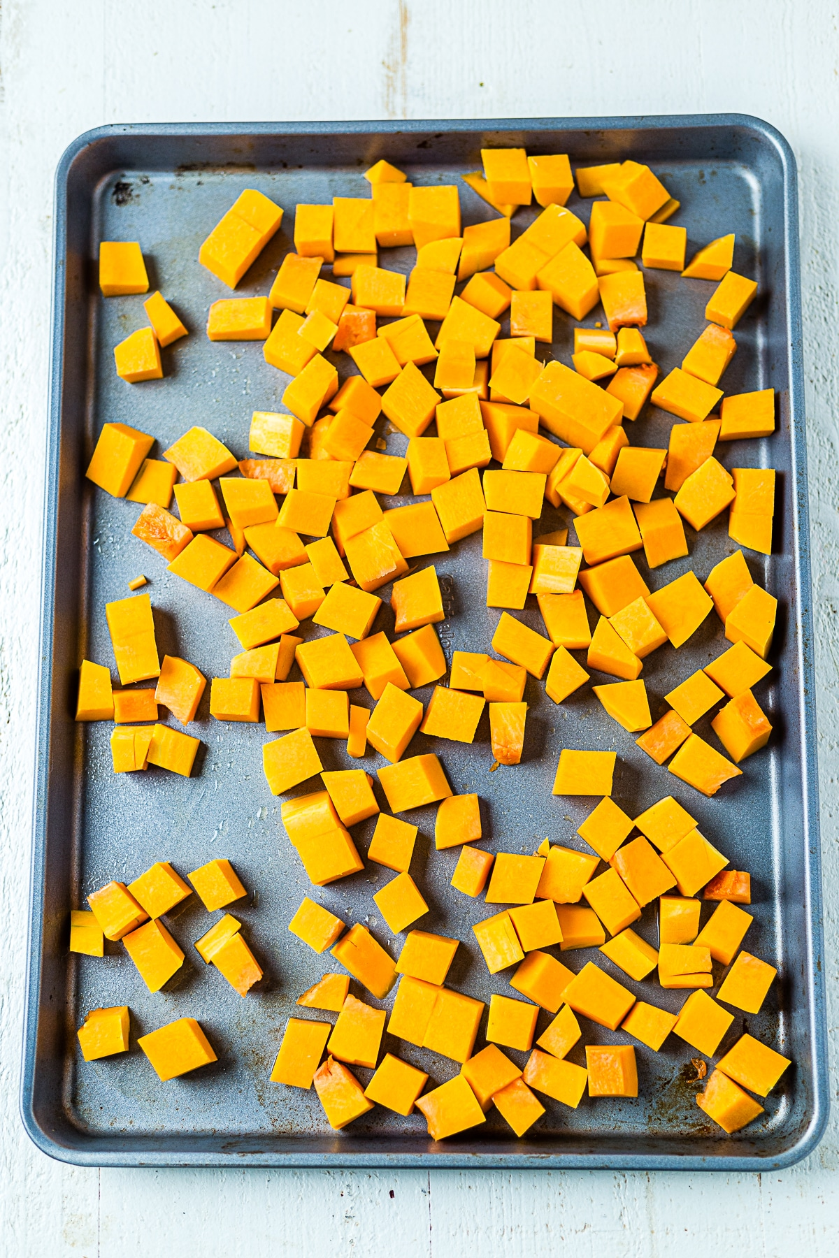 butternut squash on a baking sheet before roasting