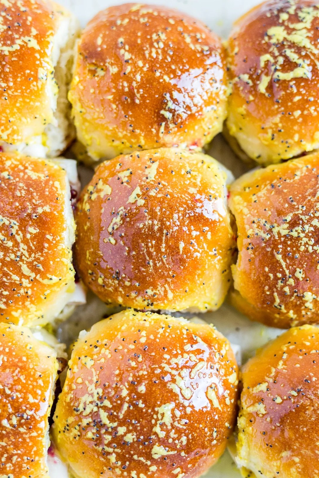 top of the buns for leftover turkey sandwiches coated with a butter mustard glaze