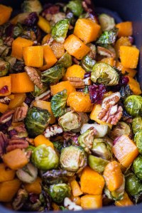 crispy butternut squash and brussel sprouts with cranberries and pecans