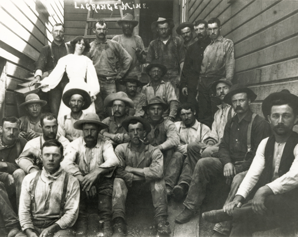 Miners were among the first customers for the new, riveted workwear, which debuted in 1873. These hardy fellows are at the La Grange Mine in California, posing for a photo in their dirty Levi's® duds.