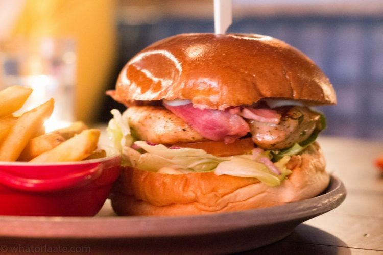 Coq Ranch Burger - Marinated Chicken Breast, Crisp Bacon, Chorizo Mayo, & a Parmesan Ranch Sauce.