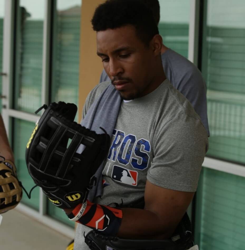 Tony Kemp Selecting a Wilson Glove