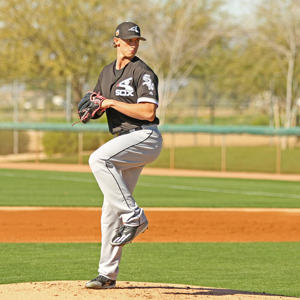 Michael Kopech pitching in the Adidas Energy Boost Icon 2