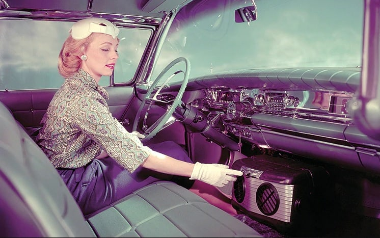 Packard invents car that is equipped with an air conditioner (A/C)
