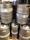 Kegs stacked up between fermenting tanks.