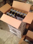 A few cases of bottled beer stacked.