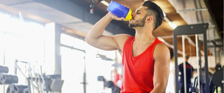 guy drinking shake in the gym