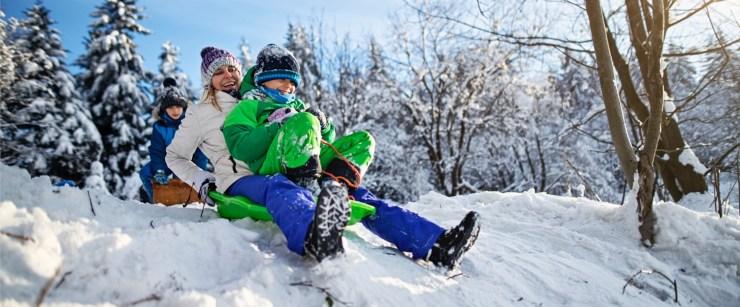mother and kids sledding
