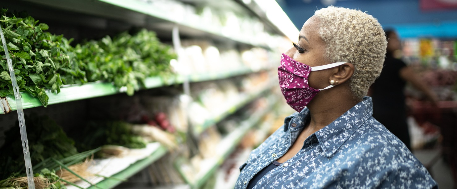 woman wearing face mask at the supermarket
