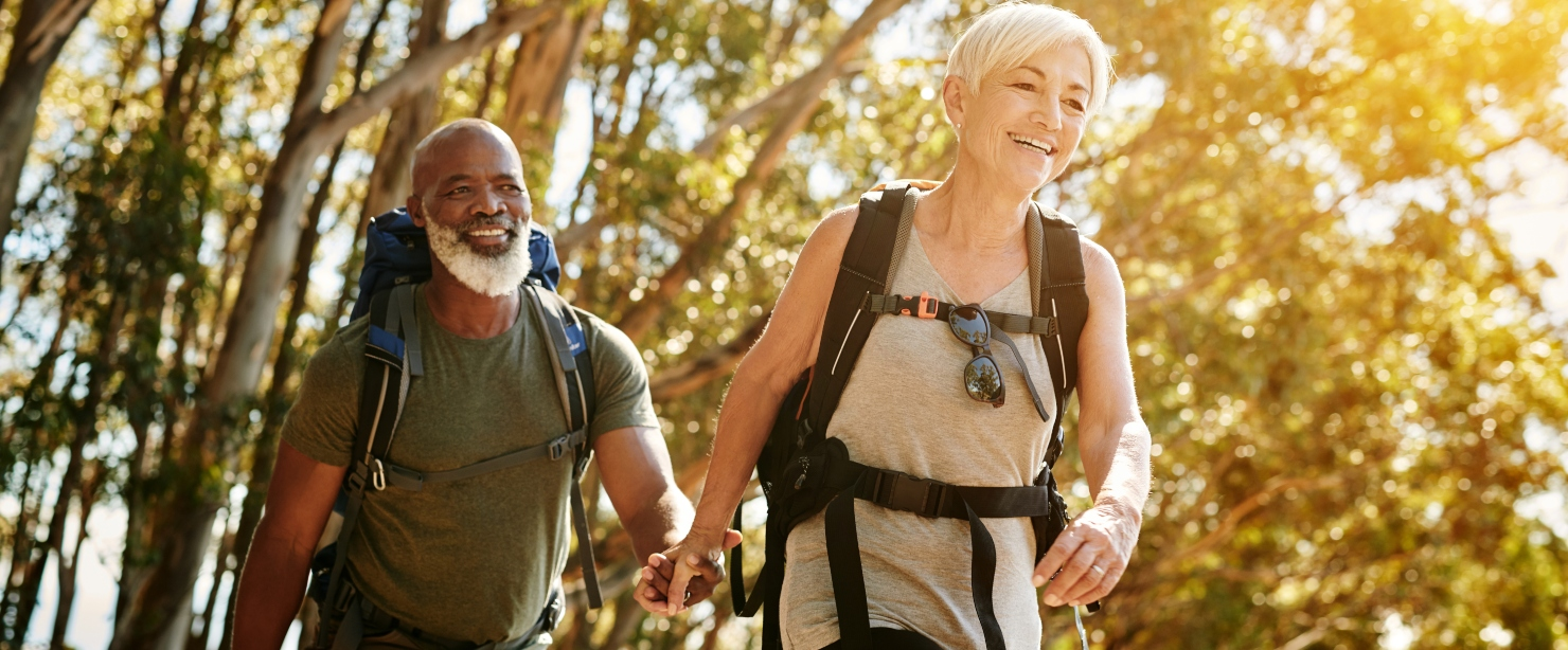 healthy living for people over 50: healthy older couple hiking together