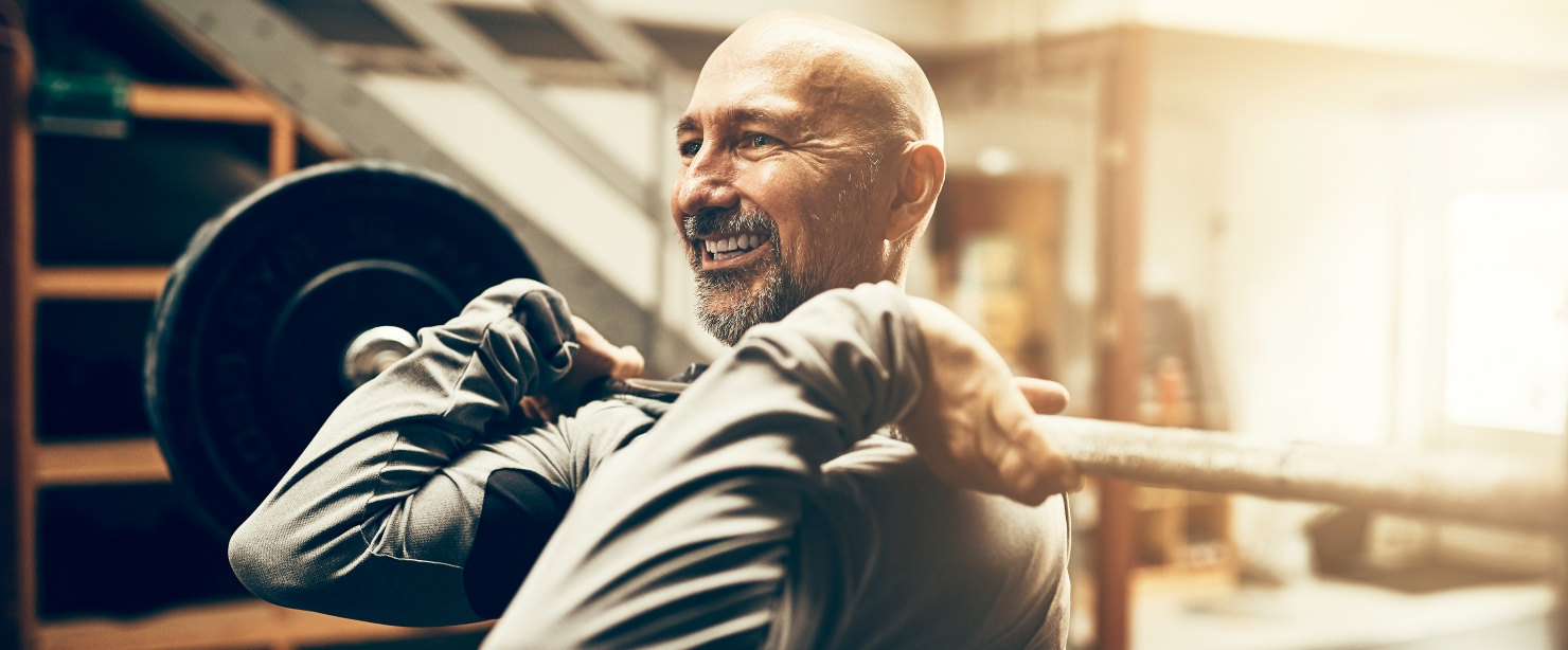 exercises middle age: older man lifting barbell