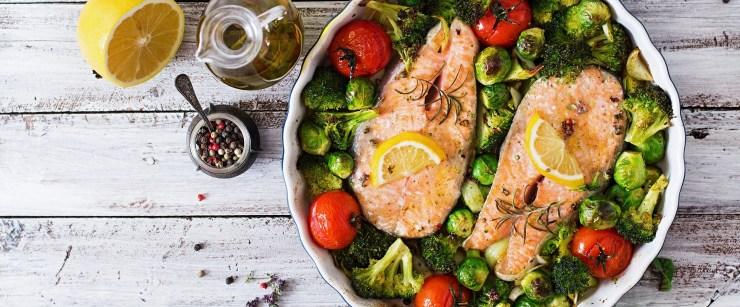 Baked salmon steak with vegetables. Diet menu. Top view