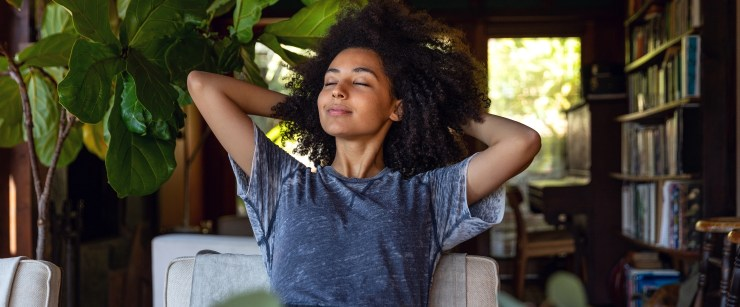 breath and anxiety: young black woman breathing at home