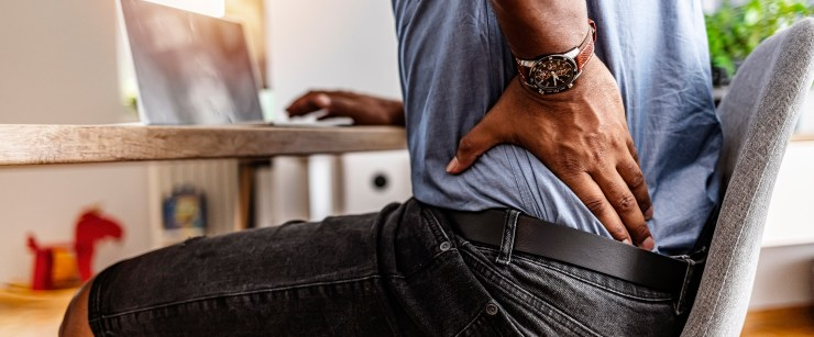 man working with lower-back pain