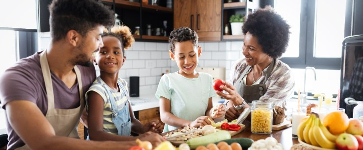 heart-healthy nutrition swaps: young black family cooking together