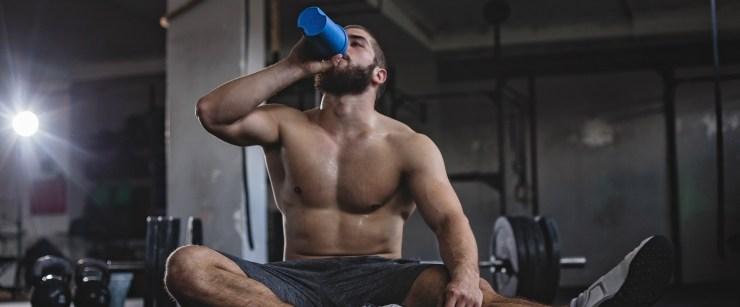 BCAA supplement: man drinking after workout