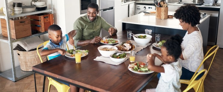 staying healthy on your busiest days: young family eating a healthy meal together