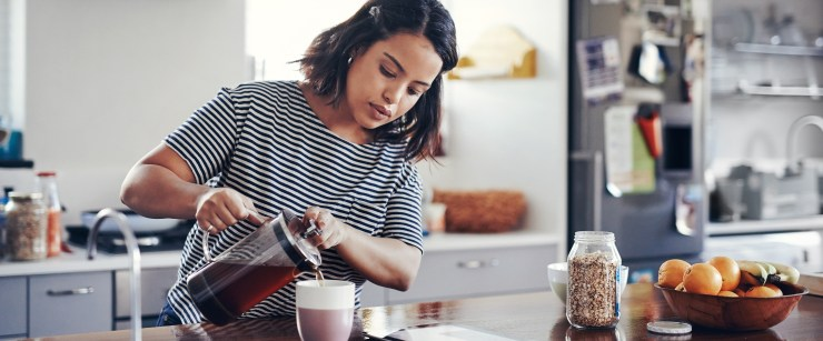 caffeine metabolizer: woman pouring coffee at home