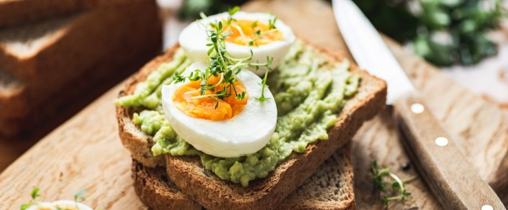 healthiest way to prepare eggs: avocado toast with hard boiled eggs