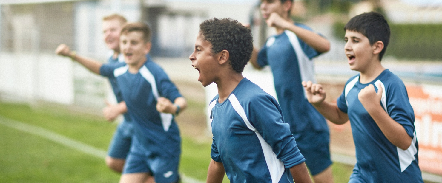 nutrients youth athletes need: young soccer players cheering